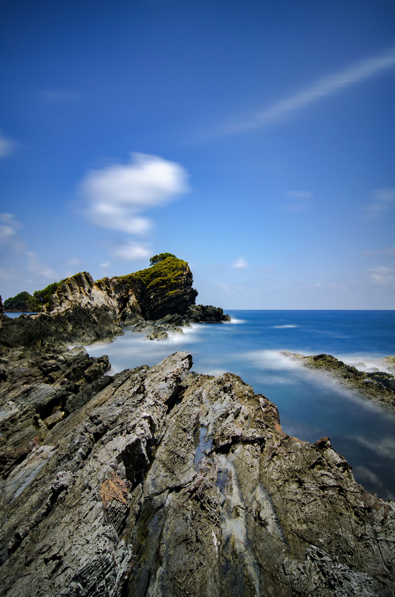 beautiful tropical sea with unique rock formation. long exposure shot. cloudy sky wnd motion effect Beach Beauty In Nature Cloud - Sky Clouds And Sky Day Horizon Over Water Island, Landscape Nature No People Outdoors Rock Rock - Object Scenery Scenics Sea Sea View Sky Vacations Water