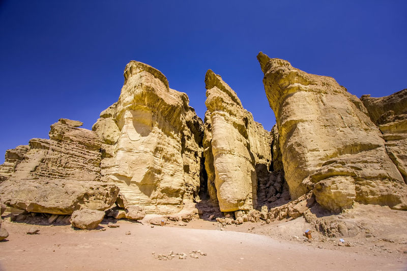 King Solomon Pillars in Timna Park, Israel Copy Space King Solomon Pillars National Park Beauty In Nature Blue Clear Sky Day Geology Israel Landscape Low Angle View Nature No People Outdoors Park Physical Geography Rock - Object Rock Formation Rock Hoodoo Scenics Sky Sunlight Timna Timna Park Tranquil Scene Tranquility