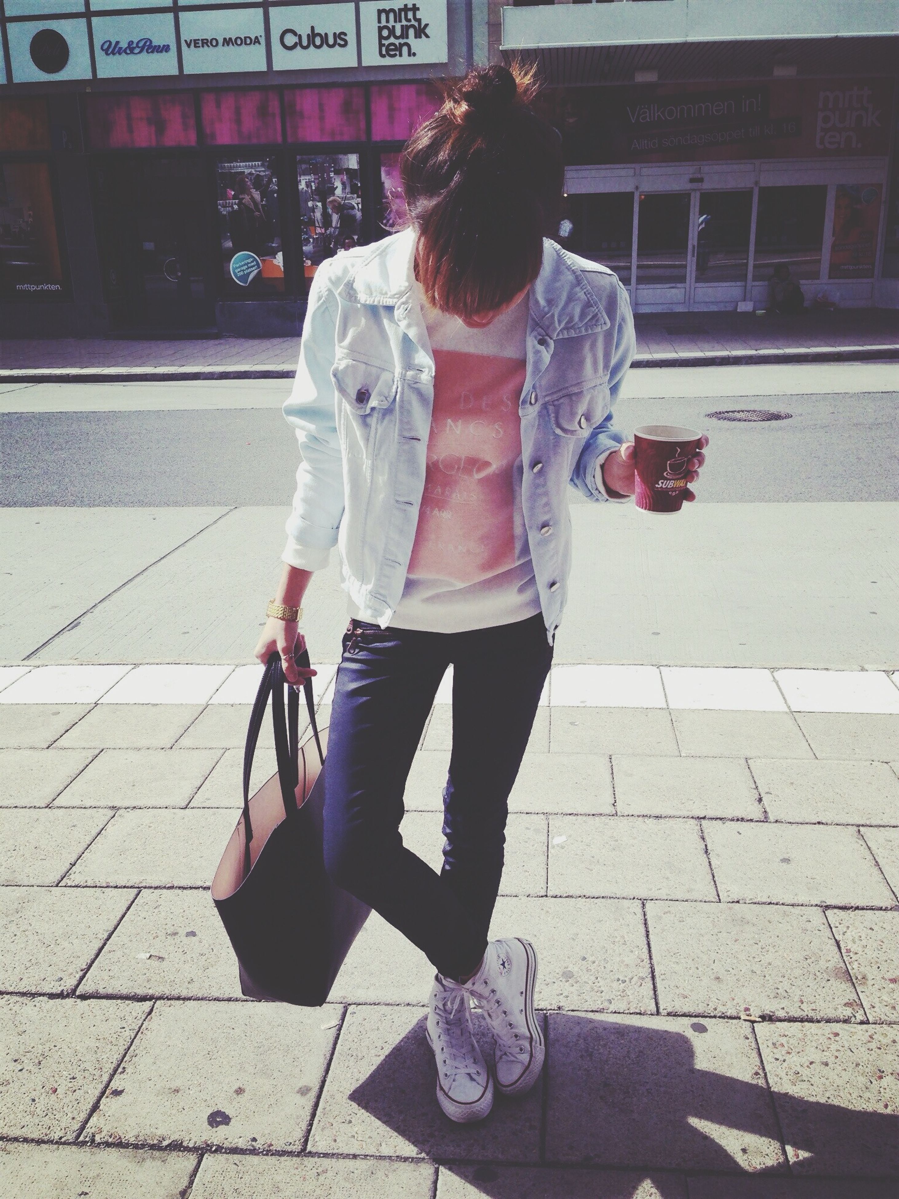 casual clothing, lifestyles, full length, street, leisure activity, standing, holding, front view, sidewalk, transportation, rear view, young adult, person, walking, city life, city, day