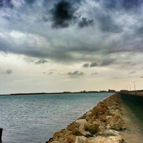 ليت كل من حولي انت، وليت كل الحكي صوتك. Aljubail AlJubail Beach. With My Friends Beach Beauty In Nature Cloud - Sky Clouds And Sky Cloudy Rainy Days Sea الجبيل المارينا