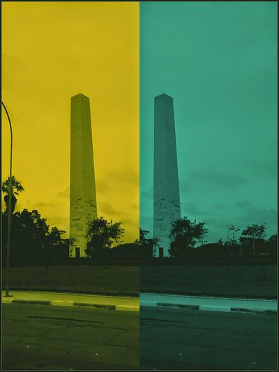 Architecture Built Structure Yellow Skyscraper Building Exterior Green Color Tree Reflection Urban Skyline Outdoors Sunset Modern No People Multi Colored Silhouette Smoke Stack Factory Shadow Sky Day