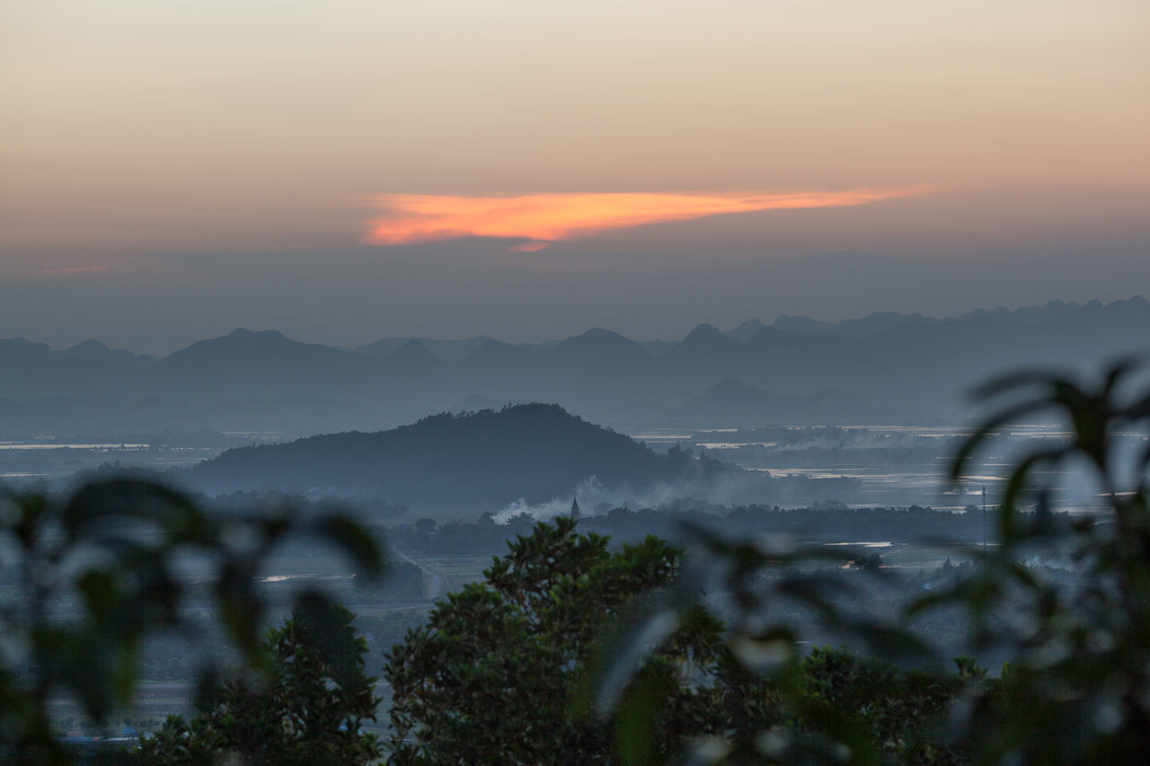 Vietnam scenery in the evening. Foggy landscape with mountains and river in the distance, trees in foreground Dusk Foggy Forest Hill Horizontal Landscape Mountain Mountain Range Nature No People Outdoors River Scenery Sky Sunset Vietnam