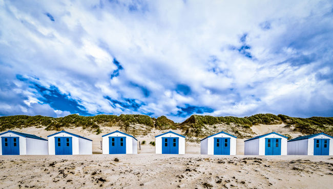 Architecture Beauty In Nature Blue Cloud Cloud - Sky Cloudy Idyllic Landscape Nature No People Non-urban Scene Sky Texel  Tourism Tranquil Scene Tranquility Travel Destinations Weather Strandhuisjes Texelstrand texel