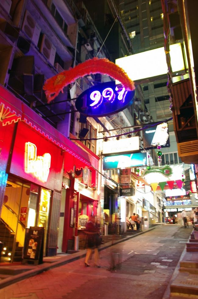 HK memories, 2009 Advertisement Architecture Building Exterior Built Structure City City Life City Street Commercial Sign Communication Footpath Illuminated Men Neon Outdoors Person Road Sign Street Text Travel Destinations Walking Lan Kwai Fong Nightphotography Streetphotography Steep Hill