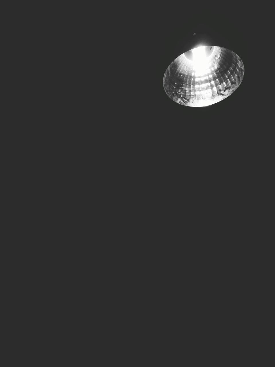 Low Angle View Of Illuminated Spotlight In Darkroom