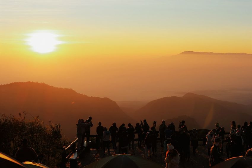 A new year first sunrise view from the high mountain of Chaing mai Thailand Cloud Lifestyle Light Orange Thailand View Warming Ang Khang Beauty In Nature Day Healthy Eating Large Group Of People Mountain Mountain Range Nature New Day Outdoors People Real People Scenics Sky Start Sunrise Sunset Tree