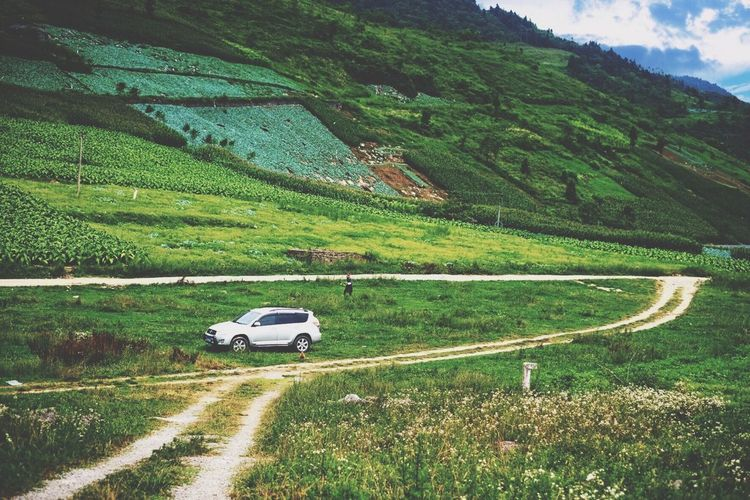 Car Landscape Land Vehicle Transportation Nature Road Field Rural Scene Green Color Mountain Travel Beauty In Nature No People 4x4 Scenics Vacations Tranquility Outdoors Day Travel Destinations