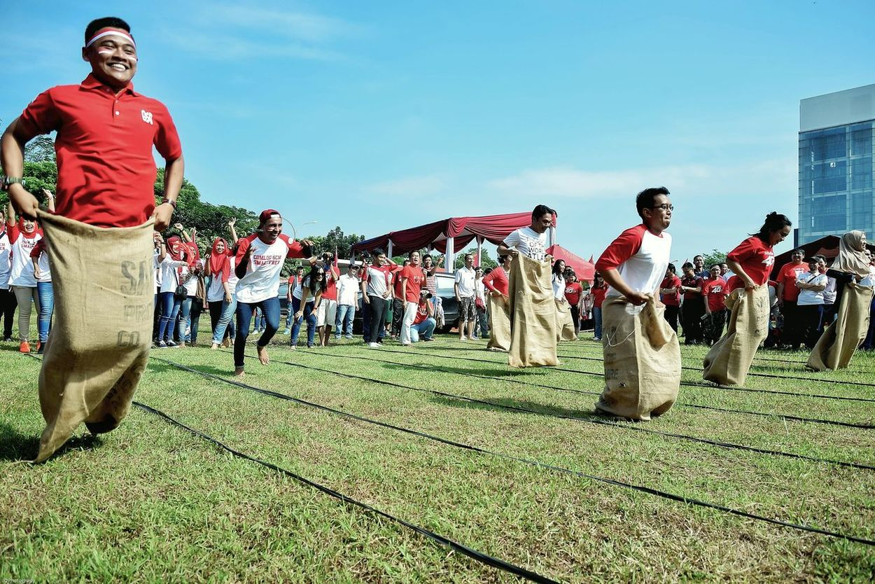 The Color Of Sport Sack Race Independence Day INDONESIA Indonesia_photography Nikon Full Length Leisure Activity Lifestyles Casual Clothing Person Grass Togetherness Young Adult Day Outdoors Sky Red Vacations