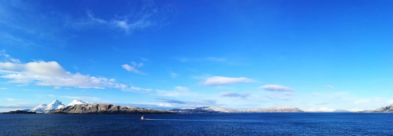 Norway Adult Beauty In Nature Blue Cloud - Sky Day Mountain Nature Nautical Vessel Norway Nature One Person Outdoors People Scenics Sea Sky Tranquil Scene Tranquility Travel Destinations Water