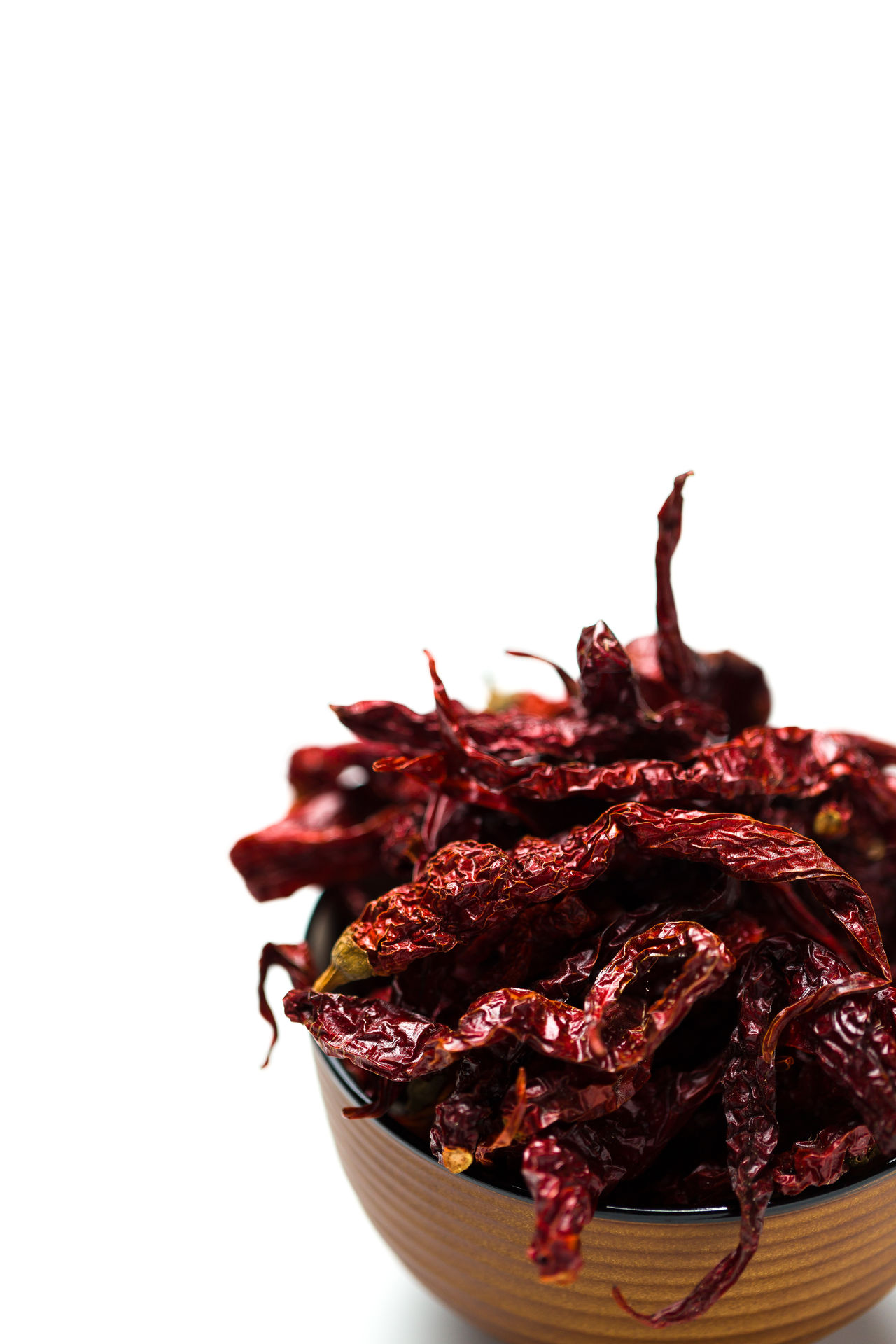 Dried chillies in a bowl isolated over white background. ASIA Cayenne Chili  Chili Pepper Chillies Cook  Cooking Cuisine Diet Dried Flavor Flavoring Food Healthy Eating Hot India Ingredient Organic Paprika Pepper Seasoning Spice Spicy Taste Tasty