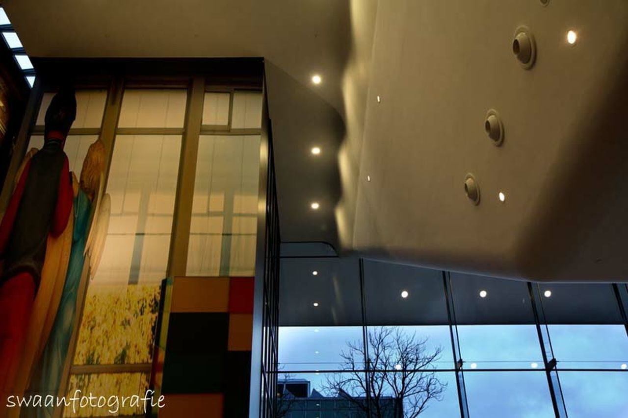 window, indoors, illuminated, architecture, no people, low angle view, built structure, building exterior, day