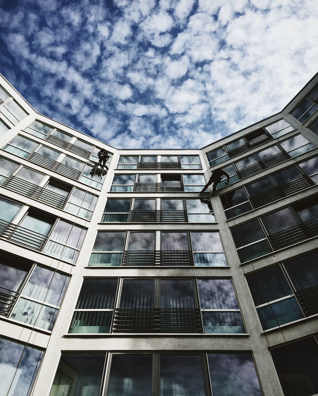 architecture, window, building exterior, low angle view, modern, sky, no people, outdoors, city, day