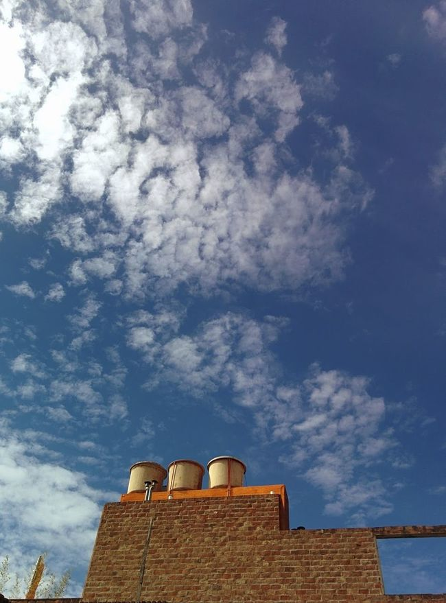 Blue Brick Building Brick Wall Bricks Bricks In The Wall Building Exterior Built Structure Cloud Cloud - Sky Day High Section Low Angle View No People Sky Water Storage Water Tower Watertank