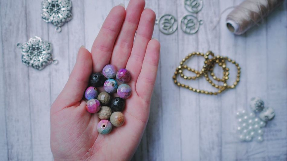 Human Hand One Person Human Body Part Real People Table Indoors  Food Close-up Multi Colored Day Agate Beads Gemstones Handmade Work Hobby Lifestyles