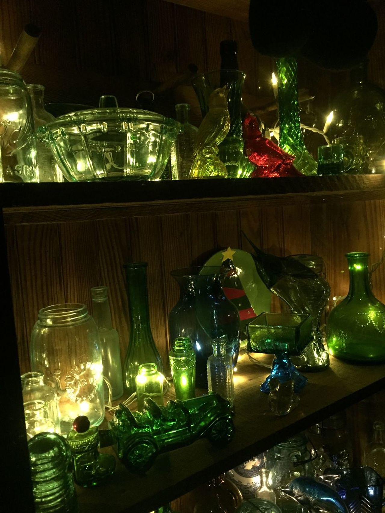 Beautiful colored glass collection. Collections Colored Glass Illuminated Indoors  Bottles Home Interior Bottles Collection Night Interior Decorating