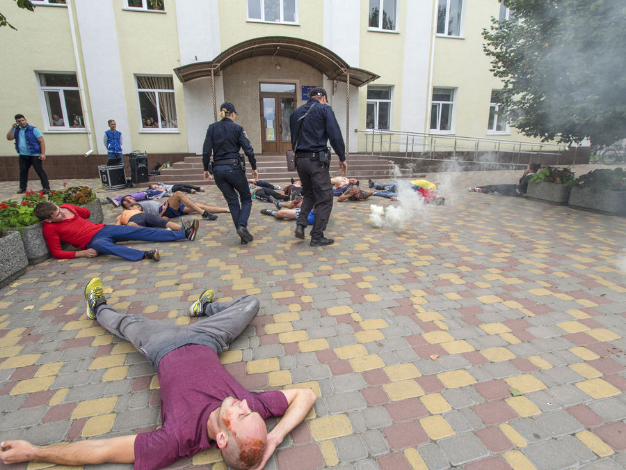 Red Cross held on Saturday, September 10, 2016, in Borispol, Ukraine training to rescue the wounded, the victims of the terrorist attacks. Architecture Attacks Building Exterior Built Structure City City Life City Street Cobblestone Day Doctor  Footpath Full Length Lifestyles Men Outdoors Paving Stone Person Police Red Cross Rescue Street Terrorist Training Victims Wounded