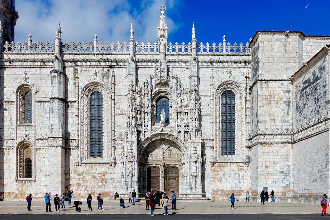 A gate of the Jeronimos monastery at Lisbon in Portugal. Architecture Blue Building Building Exterior Built Structure Clouds Day Gate Jeronimos Lisbon Monastery Ornaments Outdoors People Portugal Religion Sky Square Travel Destinations Windows