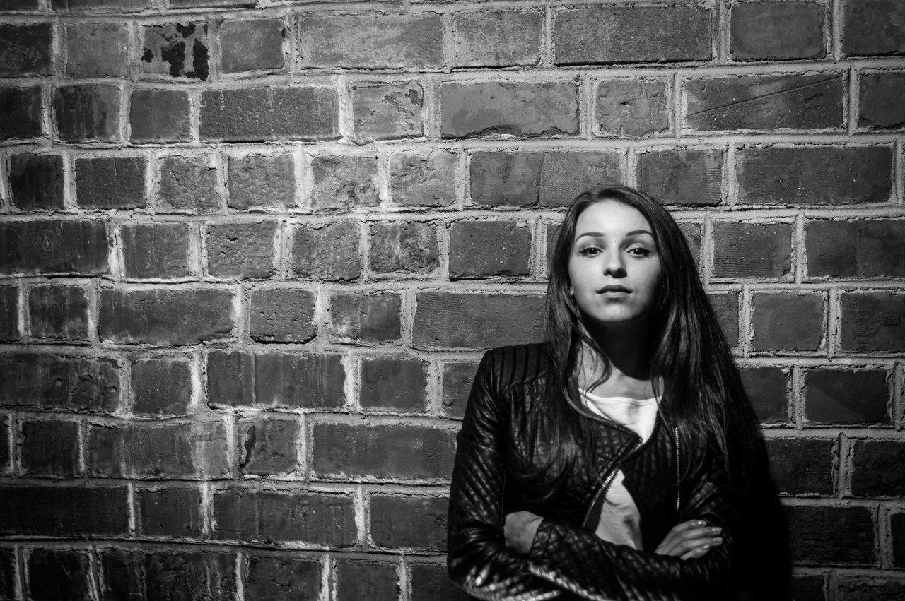 Young women on the wall background Portrait Of A Woman Portrait Beautiful B&W Portrait The Portraitist - 2015 EyeEm Awards