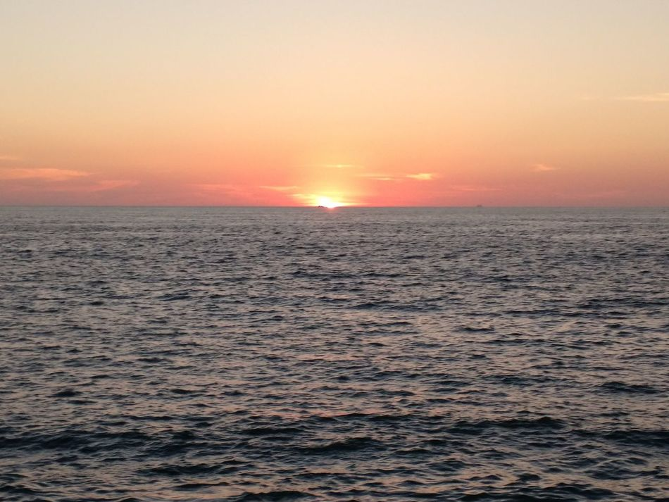 Sunset Sea Tourism Travel Destinations Scenics Water Travel Tranquility Outdoors Landscape Nature Sky Beauty In Nature City Tranquil Scene Vacations Romantic Sky Fog Horizon Over Water No People Mexican Sunsets