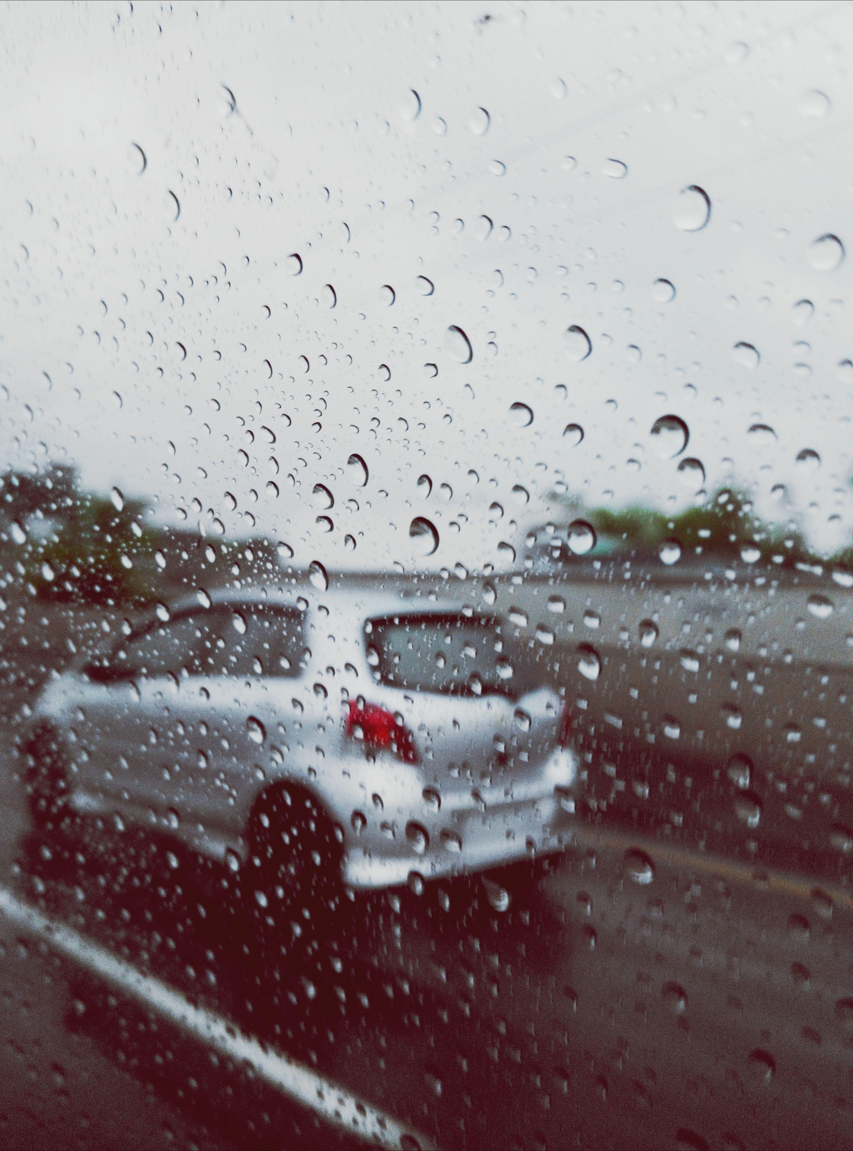 wet, drop, window, rain, transportation, transparent, glass - material, weather, season, water, mode of transport, car, vehicle interior, indoors, raindrop, land vehicle, sky, car interior, windshield, road