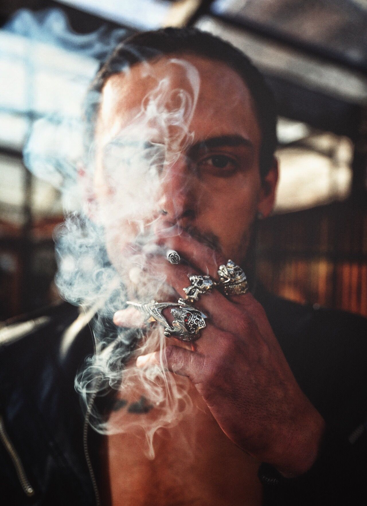 Fashion smoking - activity smoking issues smoke - physical structure lifestyles real people indoors ring Runway human hand fashion photography human body part