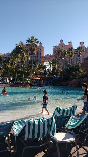 Water Luxury Swimming Pool Outdoors Vacations People Day Vacations Travel Destinations Caribbean Sunny Day Fun View Children Honeymoon Destination Family Time Holidays Hotel Waterpark Palm Trees Paradise Island Nassau Atlantis Bahamas