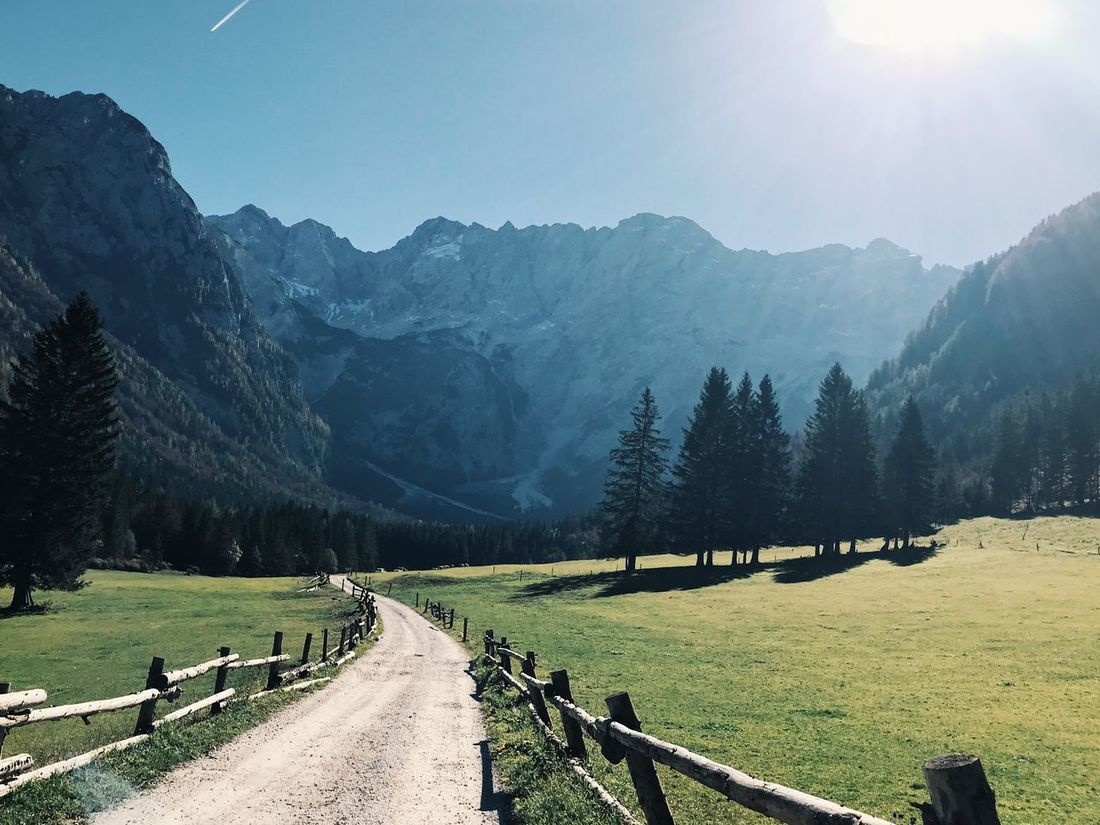 Let me go. Mountain Tranquility Tranquil Scene Nature Sunlight Scenics Railing Beauty In Nature Landscape Day Mountain Range Outdoors No People Sky Tree Grass Clear Sky
