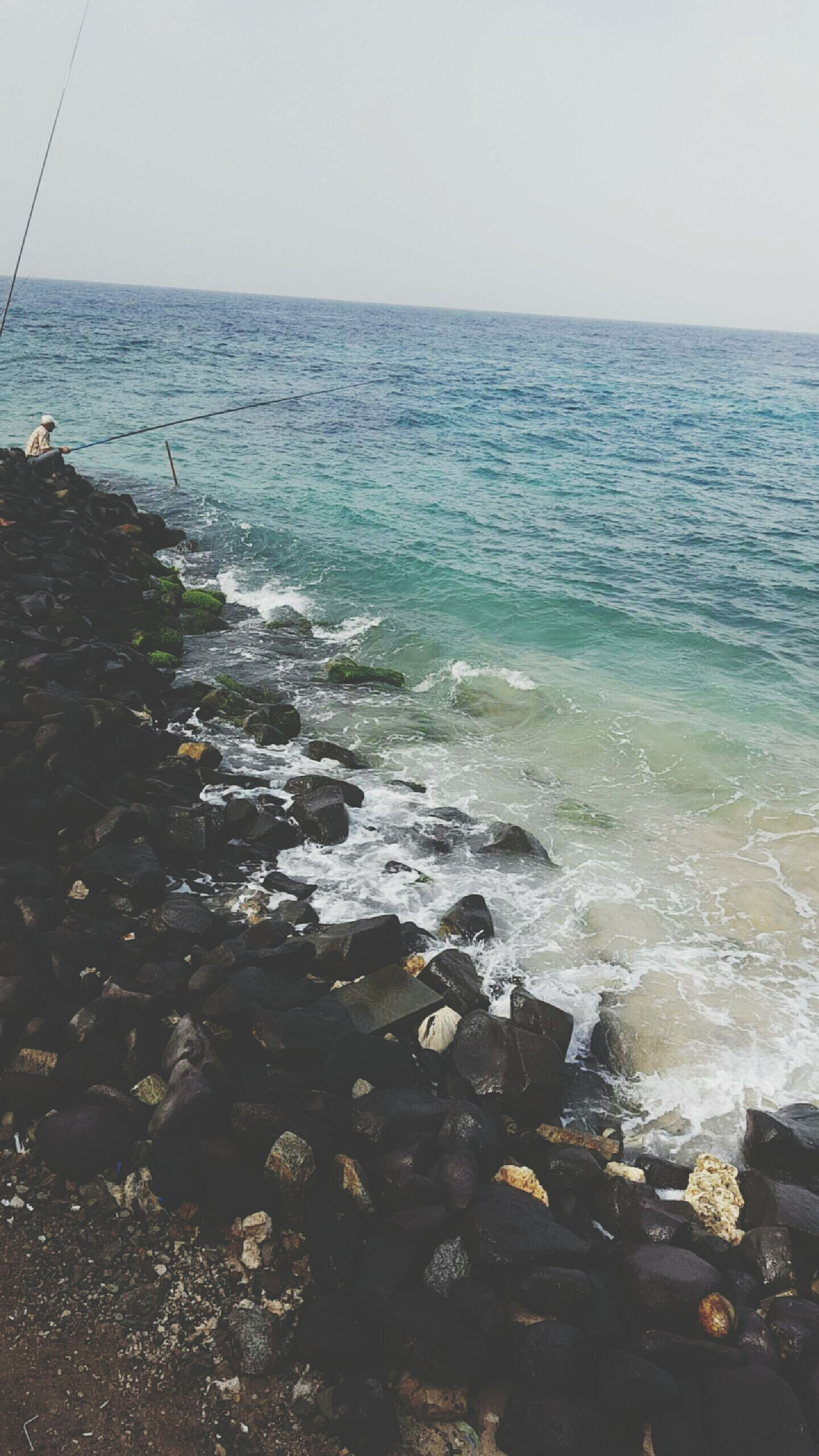 water, sea, horizon over water, scenics, beach, tranquil scene, tranquility, beauty in nature, sky, shore, nature, clear sky, idyllic, wave, rock - object, day, seascape, remote, outdoors, copy space