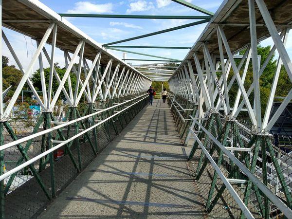 Bridge - Man Made Structure Connection Engineering Architecture Built Structure Footbridge Metal Transportation Suspension Bridge Day Outdoors People City Metallic