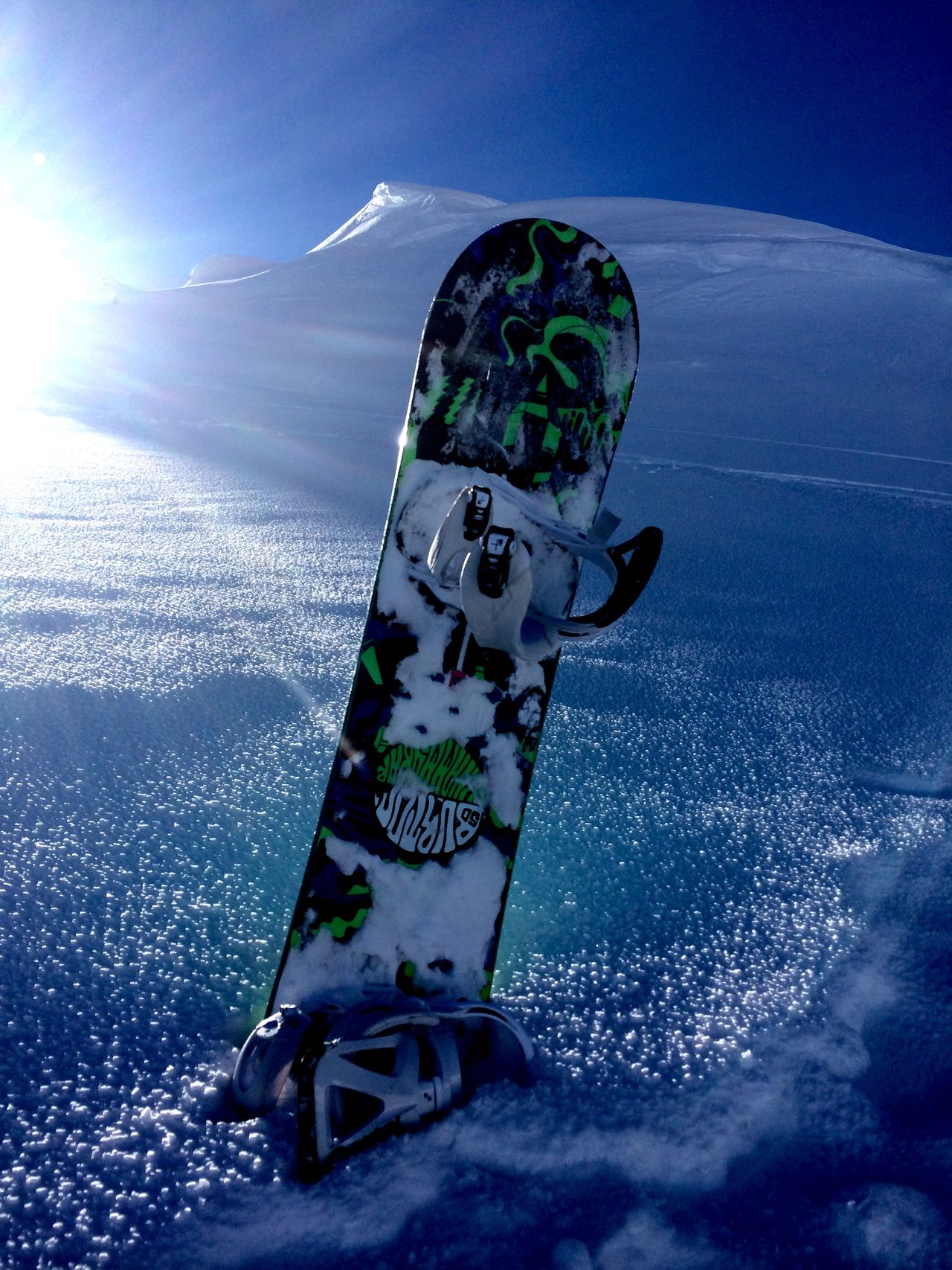 A Snowboard standing in the Snow on the Mountain with the Light leaking from the side. Sun Snowboarding Meribel Creative Light And Shadow Snow Sports