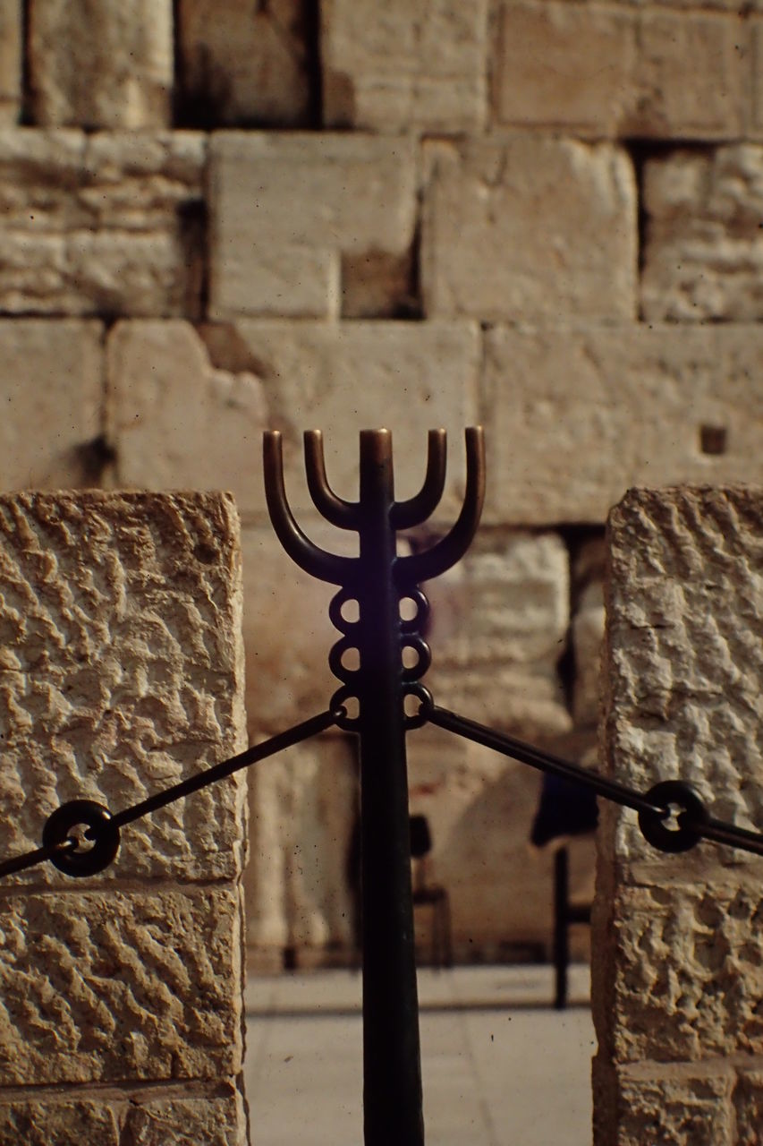 Menorah Against Wall At Synagogue