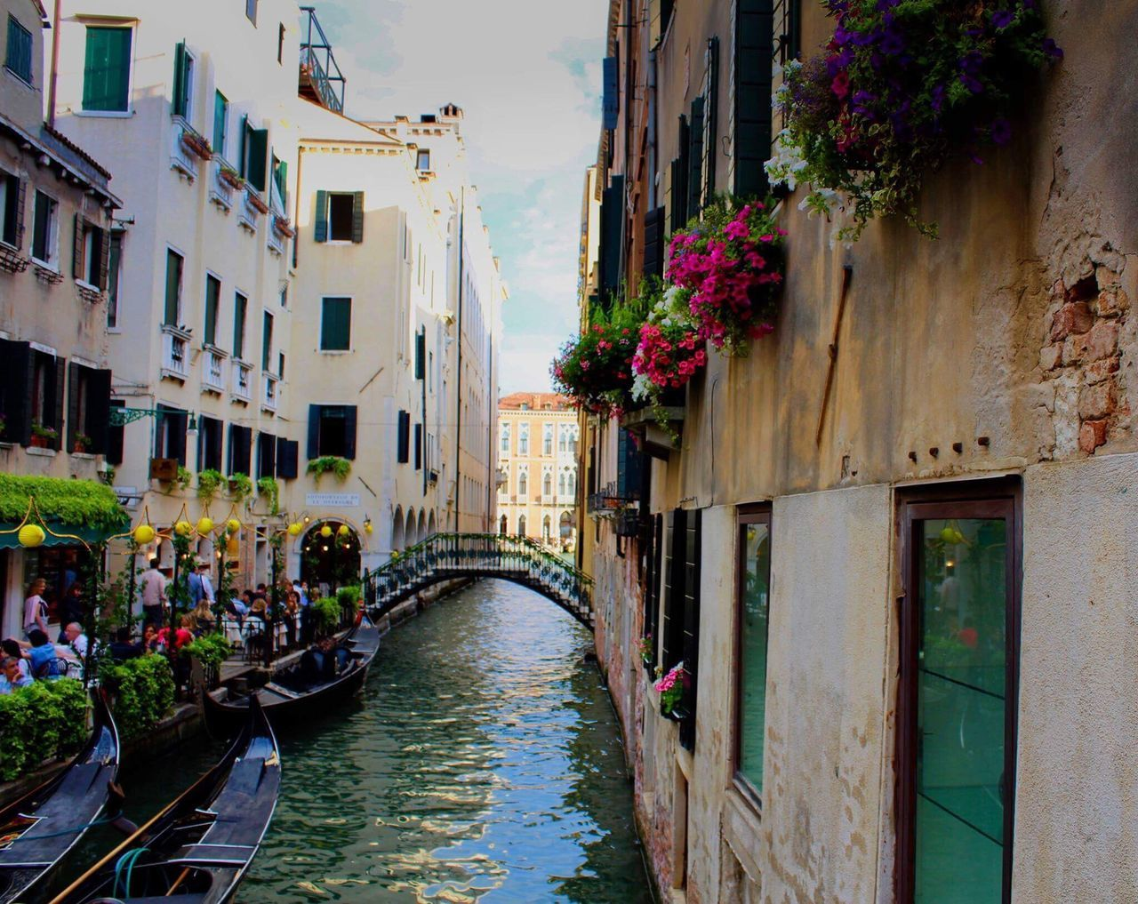 architecture, canal, building exterior, built structure, old town, day, gondola - traditional boat, travel destinations, water, outdoors, nautical vessel, no people