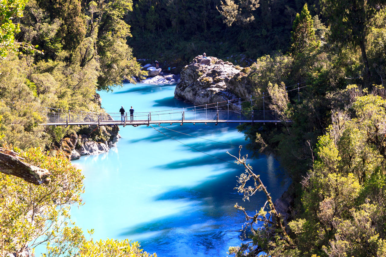 The blue waters at the Hokitika Gorge Beauty In Nature Blue Blue Water Bridge - Man Made Structure Day Eye4photography  EyeEm Best Shots EyeEm Nature Lover Mountain Nature One Person Outdoors People Real People Rock - Object Scenics Sky Tranquil Scene Tree Water