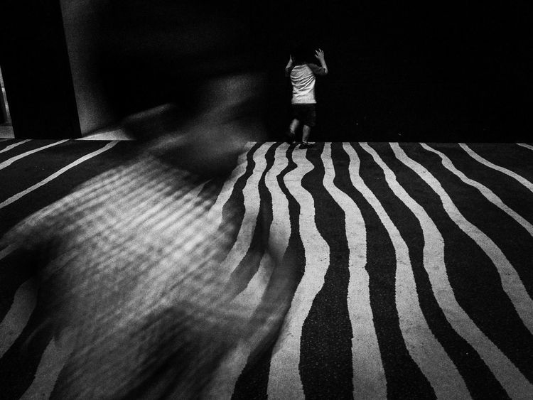 Hide and seek Blackandwhite Hideandseek Childhood Playing Carpet LINE Mobile One Person Real People Standing Full Length Low Section Lifestyles Indoors  Childhood