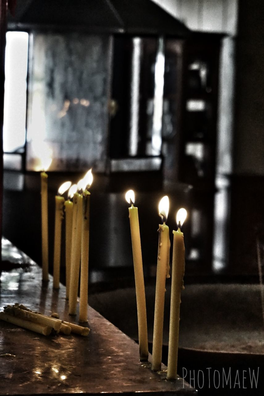 candle, religion, flame, burning, spirituality, place of worship, indoors, table, illuminated, heat - temperature, focus on foreground, no people, altar, close-up, day