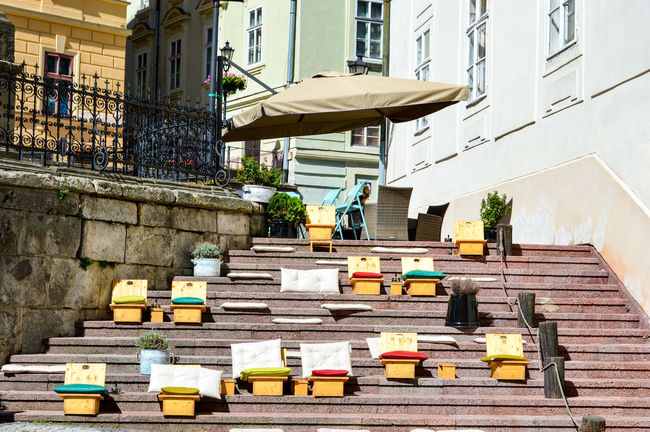 BanskáŠtiavnica Chairs Seats Streetphoto Street Life Urban Urban Lifestyle Urban Photography Urban Perspectives Built Structure Architecture Building Exterior City Low Angle View Outdoors No People Stairs Simplicity From My Point Of View EyeEm Best Shots TheWeekOnEyeEM Group Of Objects In A Row Urban Street Street