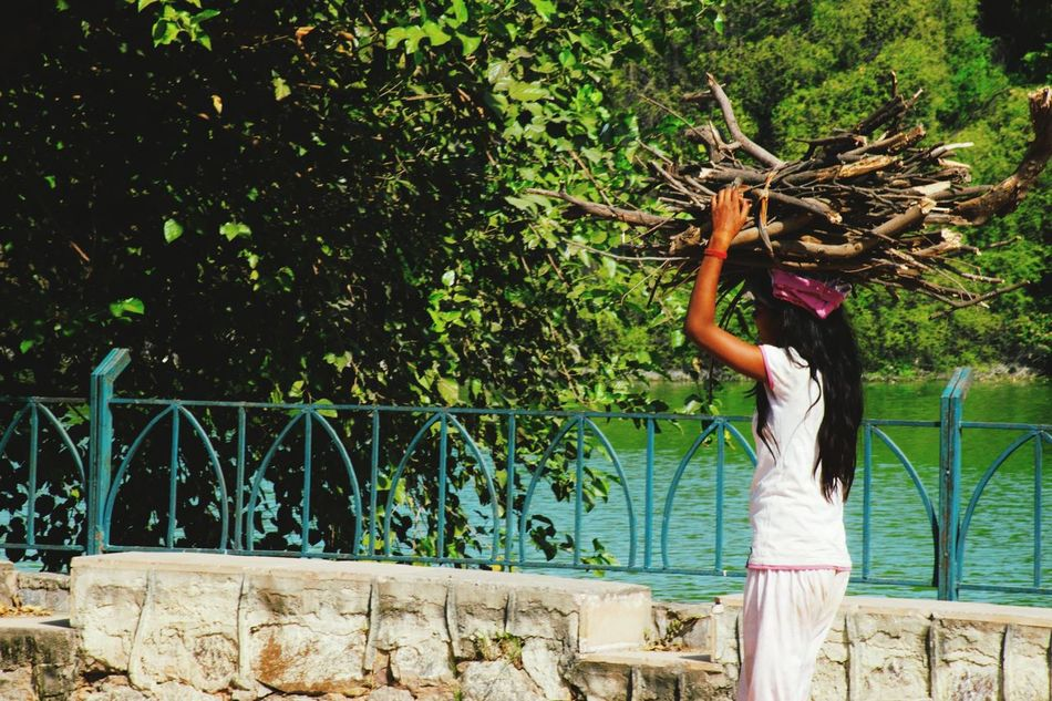 People Peoplephotograpy Streetphotography Portrait Poor Kids Poverty. Looking For The Hope Of Light. Hardwork Lake Trees Green TreePorn Trees And Sky Treeexpression
