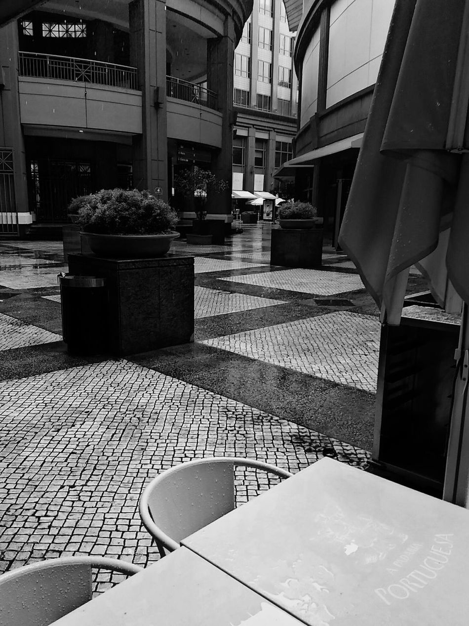 Showcase March Check This Out No People Wall - Building Feature EyeEm Best Shots Cobblestone Wet Pavement Rainy Day Absence Outdoors Rain Raining Steel Table Rainy Cobblestone Pavement Winter Time Standing In The Rain Grey Sky No Sun Need An Umbrella Walking In The Rain Flower Pot Outside Grey Day Winter Day
