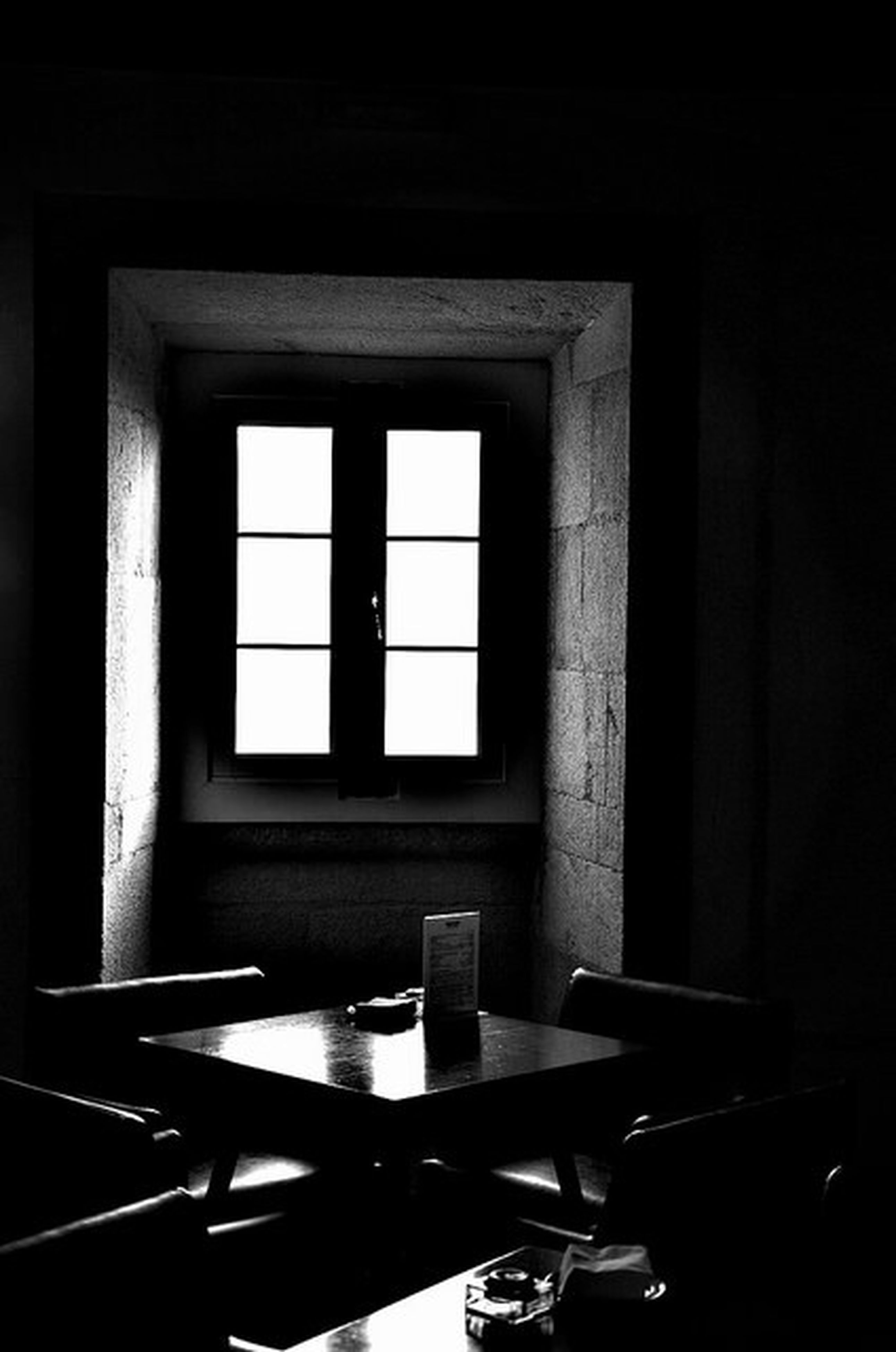 indoors, window, table, chair, home interior, glass - material, absence, architecture, no people, empty, built structure, still life, transparent, day, house, restaurant, wall, sunlight, glass, dark