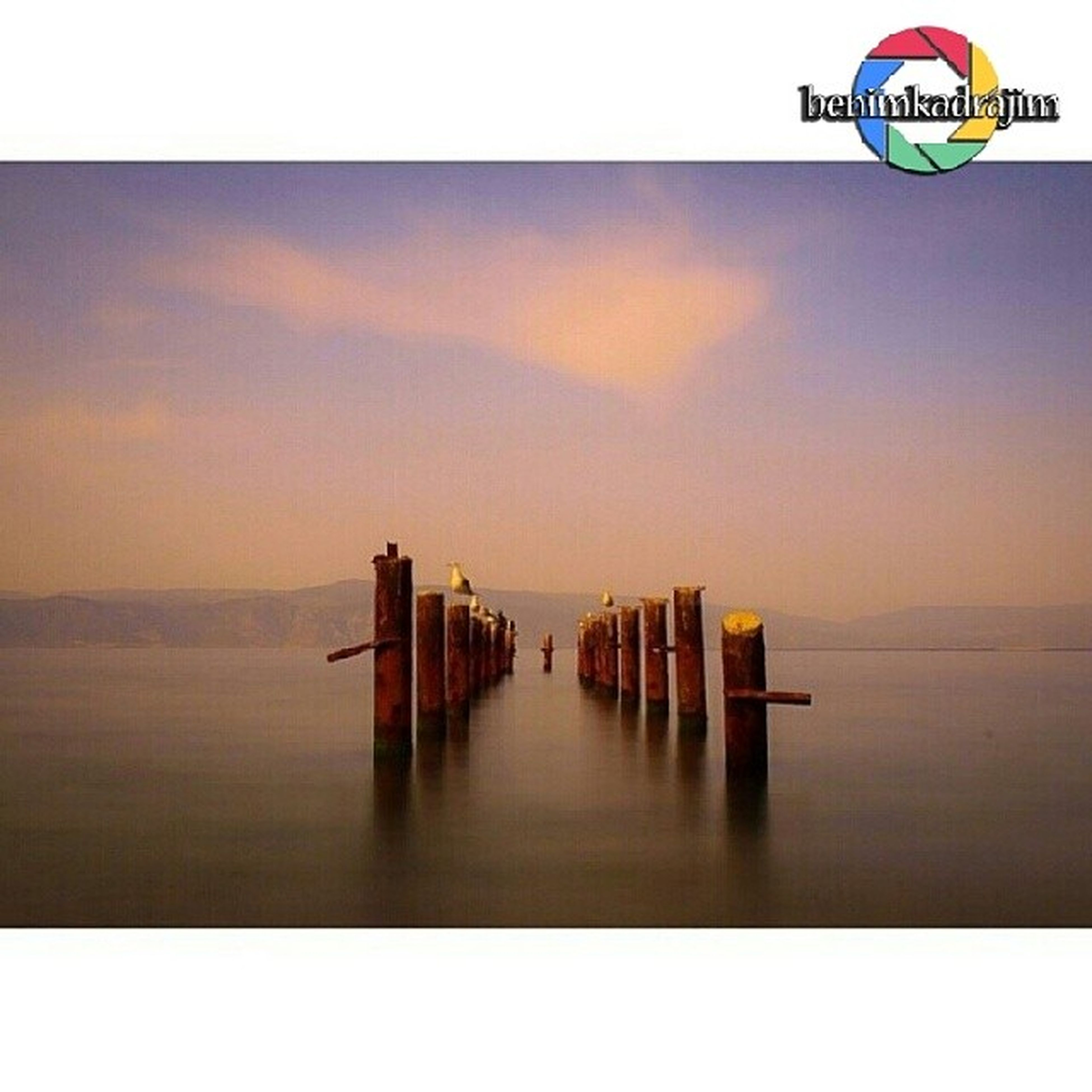water, sea, pier, sky, sunset, tranquil scene, horizon over water, tranquility, waterfront, built structure, transfer print, scenics, auto post production filter, reflection, nature, beauty in nature, architecture, jetty, outdoors, calm