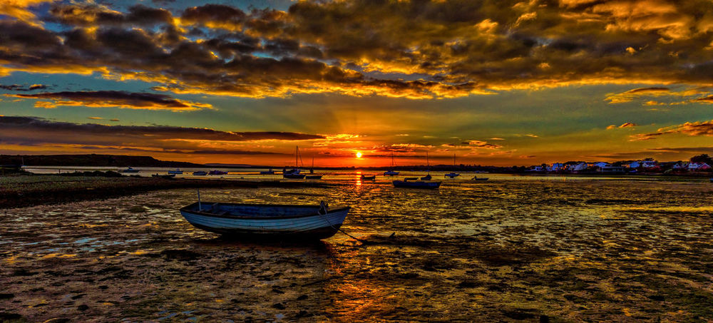 Sunset over Christchurch Harbour Beauty In Nature Christchurch Harbour Cloud Cloud - Sky Cloudy Dramatic Sky Idyllic Moody Sky Mudeford Mudeford Quay Nature No People Non-urban Scene Orange Color Outdoors Scenics Shore Sky Sun Sunset Tranquil Scene Water Weather