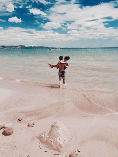 EyEmNewHere Beach Sea Sand Full Length Vacations Carefree Lifestyles Enjoyment Cheerful Fun Leisure Activity Outdoors People Human Body Part Tropical Climate Adult Horizon Over Water Real People Sky Love Feelings OneAndOnly Iphonephotography