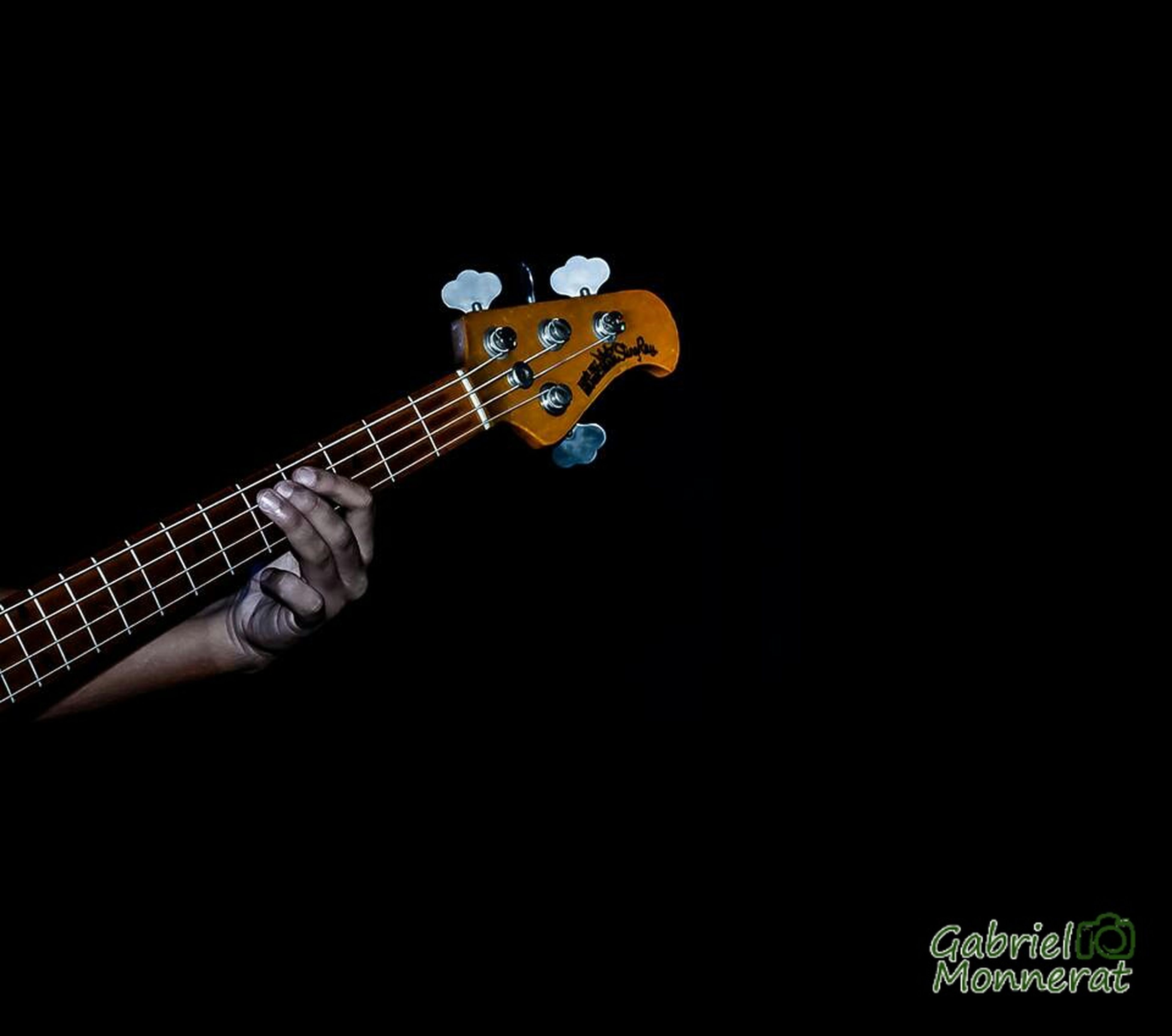 music, guitar, arts culture and entertainment, musical instrument, studio shot, night, black background, musical instrument string, musical equipment, indoors, copy space, low angle view, holding, illuminated, person, skill, communication, technology