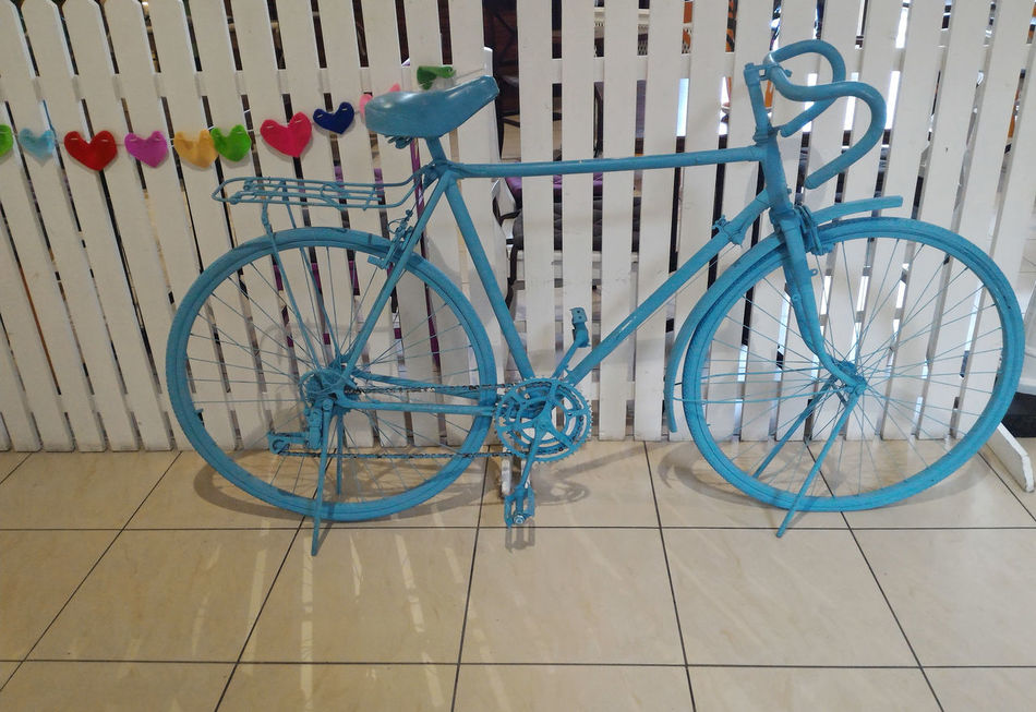 Blue old vintage bicycle, interior design Art Art Is Everywhere Bicycle Bicycle Rack Bicycles Blue Blue Color Cycle Decoration Hearts Interior Interior Decorating Interior Design Interior Style Land Vehicle Mode Of Transport Multi Colored No People Old Stationary Transport Transportation Vintage