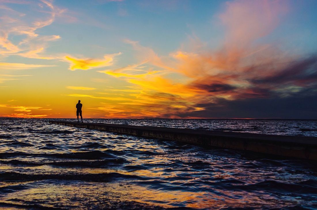 Silhouette of a man and his dark sea at sunset. Silhouette Sunset Ocean Sea Evening Sky Evening Light Man Adult Man Silhouette Sky Clouds Crimson Sky Crimson Tide  Waves Jetty View Sea And Sky Seascape Alone Horizon Over Water Nature Ripples Baltic Sea One Person Standing Lost In The Landscape