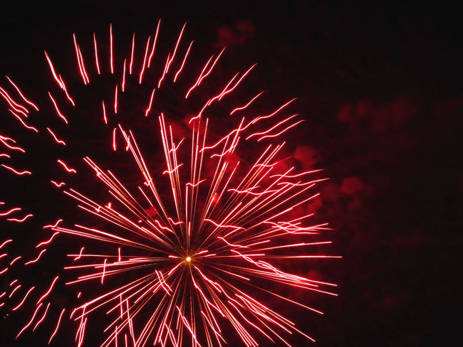 Colorful fireworks of various colors light up the night sky Anniversary Background Black Burst Celebrate Celebration Dark Display Event Exploding Explosion Festive Fire Firework Fireworks Fourth Of July Holiday Isolated On Black Light New Year Night Pyrotechnics Red Show Sky