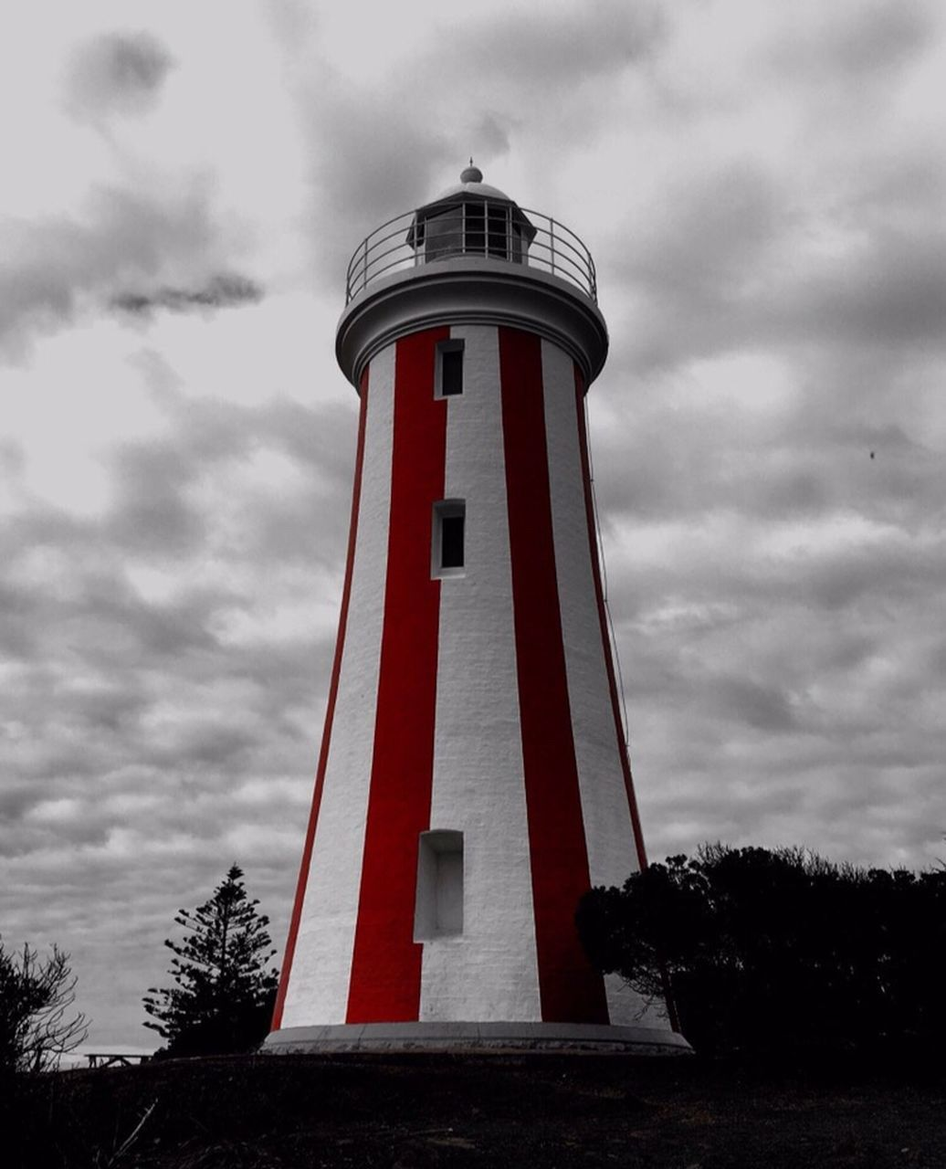 lighthouse, cloud - sky, sky, safety, tower, low angle view, protection, guidance, day, direction, outdoors, tree, architecture, red, no people, building exterior, built structure, nature