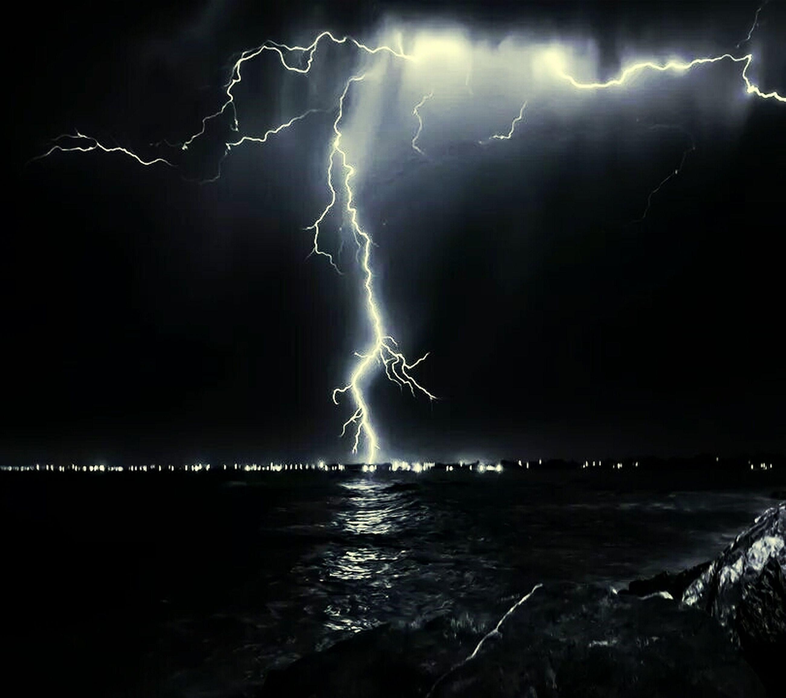 night, illuminated, long exposure, power in nature, water, sky, motion, lightning, thunderstorm, storm, glowing, sea, danger, scenics, beauty in nature, storm cloud, firework display, smoke - physical structure, light - natural phenomenon, splashing