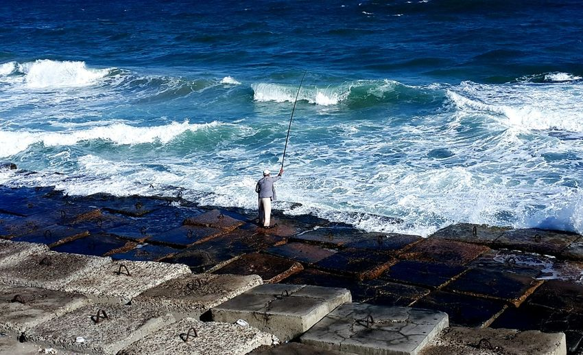 old man fishing Sea Water Fishing Standing Outdoors Beauty In Nature Men People Sky Nature The Photojournalist - 2017 EyeEm Awards Visual Feast