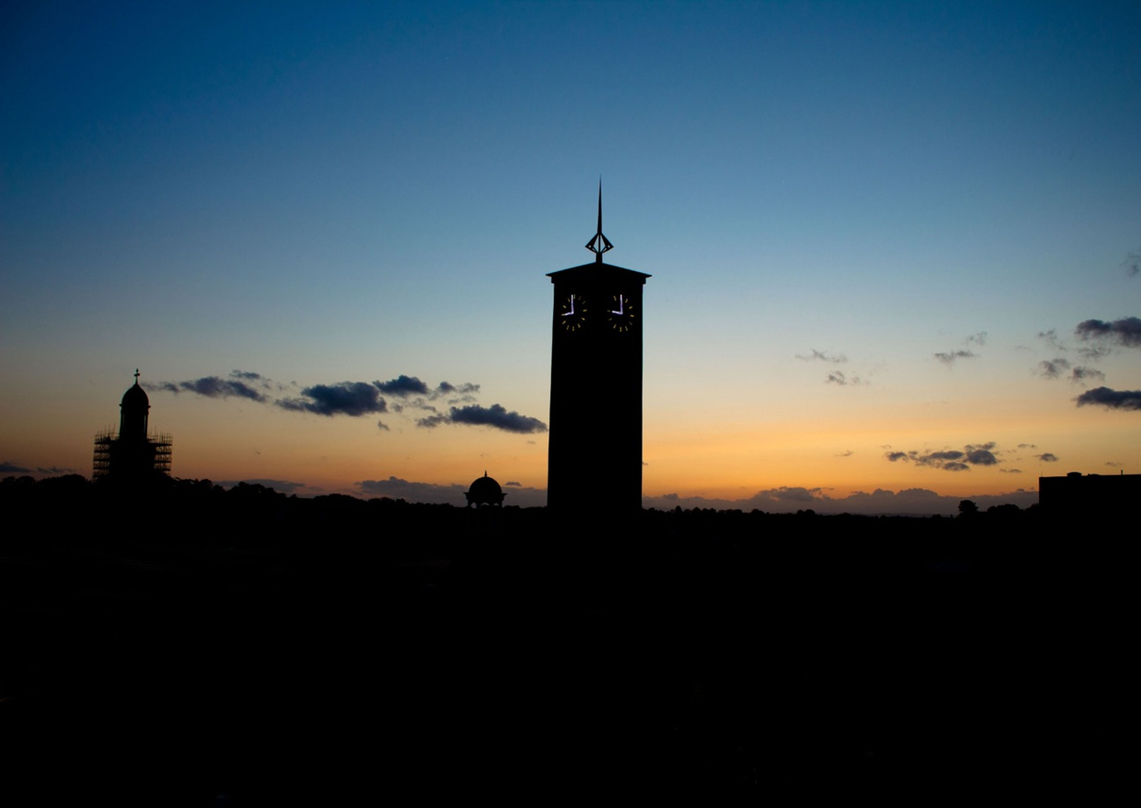sunset, building exterior, silhouette, architecture, built structure, tower, copy space, sky, guidance, orange color, lighthouse, low angle view, blue, dusk, direction, no people, outdoors, clear sky, nature, scenics